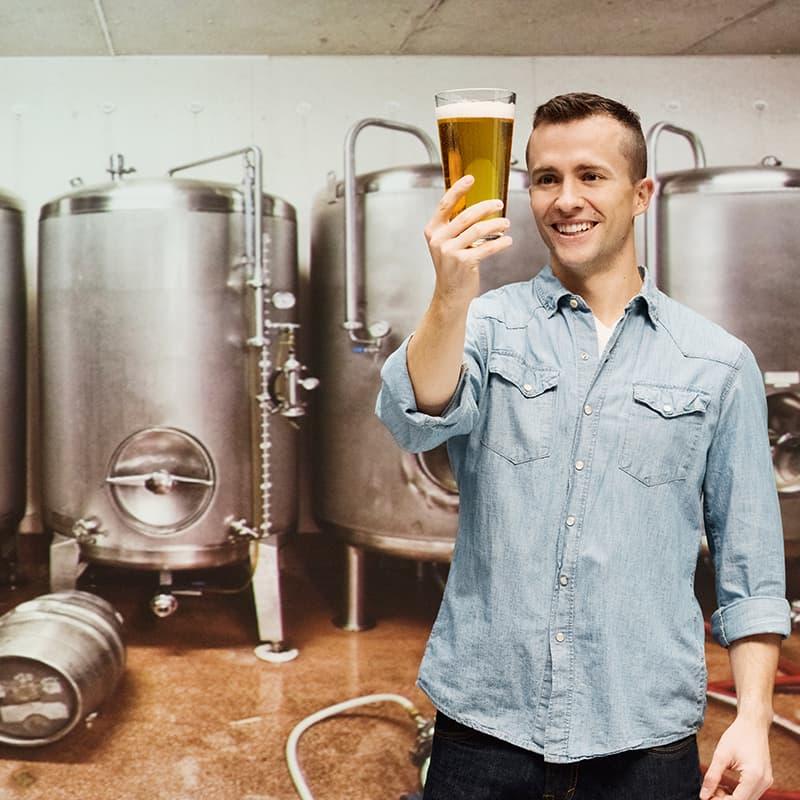 https://www.honeysource.com/wp-content/uploads/2021/05/brewer-looking-at-beer.jpg