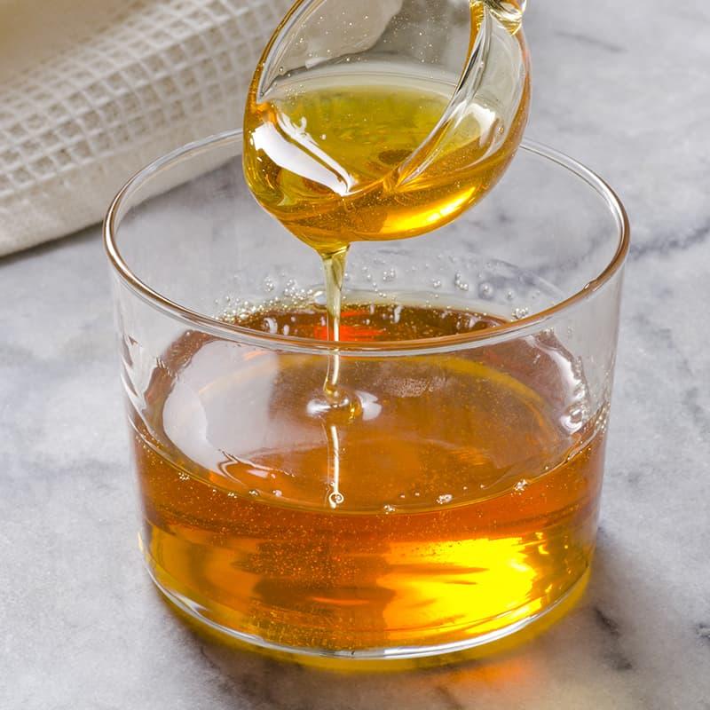 https://www.honeysource.com/wp-content/uploads/2021/05/pour-honey-jar.jpg